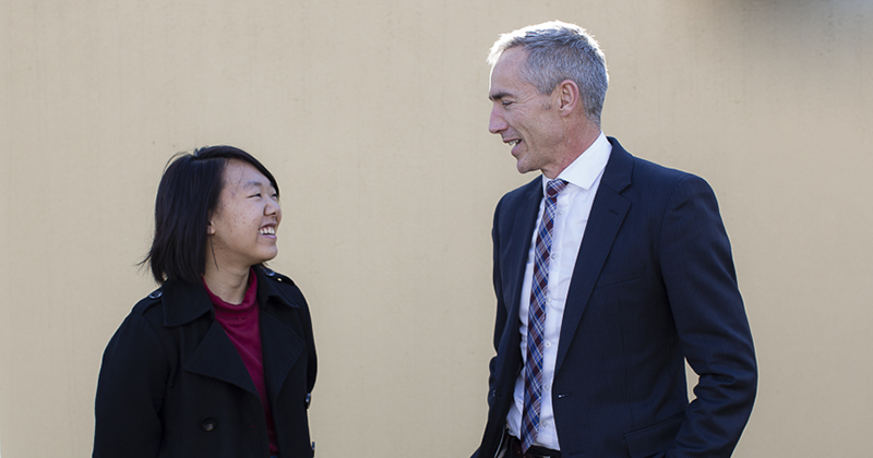 A photo of APRA AMCOS Chief Executive Dean Ormston and Natsuko Yonezawa looking at each other and smiling