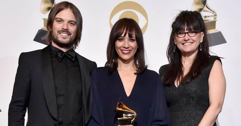 Alan Hicks, Rashida Jones and Paula DuPré Pesmen stand holding their Grammy award