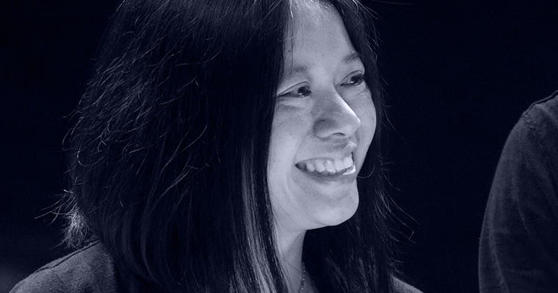 Black and white photo of composer Liza Lim smiling